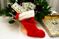 Christmas stocking full of cash Stock Photography