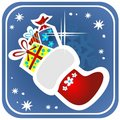 Christmas stocking with gifts Royalty Free Stock Photo