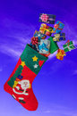 Christmas stocking and gifts flying in the sky. Royalty Free Stock Photo