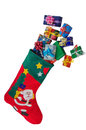 Christmas stocking and gifts isolated over white. Royalty Free Stock Photo