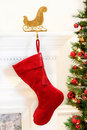 Christmas stocking hanging mantelpiece Royalty Free Stock Photography