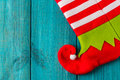 Christmas stocking holiday on vintage blue wooden background elf boot Royalty Free Stock Images