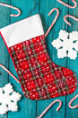 Christmas stocking holiday on vintage blue wooden background snowflakes and candy canes Royalty Free Stock Images