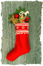 Christmas stocking with nostalgic antique toy deco decoration and pine branch over wooden background vintage style picture snow Royalty Free Stock Photo