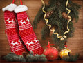 Christmas stocking pine cones and branches. decorations on wooden rustic background  close up Royalty Free Stock Photo