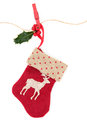 Christmas stocking reindeer with holly berry leaf sprig on a string line with peg over white background Stock Photography