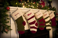 Christmas Stockings by the fireplace Royalty Free Stock Image