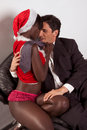 Christmas striper Mrs Santa Claus seducing man Royalty Free Stock Images