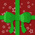 Christmas surprise gift in wrapping paper and green ribbon Royalty Free Stock Photo