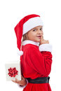 Christmas surprise with little girl dressed as santa holding present isolated Stock Image