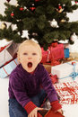 Christmas - Surprised child opening gifts Stock Images