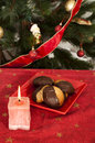 Christmas sweets and candle on the table Royalty Free Stock Photos