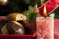Christmas sweets and candle on the table Royalty Free Stock Photography