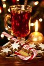 Christmas sweets cookies and candy cane with tea and decorations Stock Images