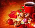Christmas sweets still life on wooden table in cozy cafe red cup with coffee homemade gingerbread warm candle light traditional Stock Photo