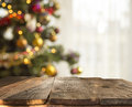 Christmas table background with christmas tree out of focus Royalty Free Stock Photo