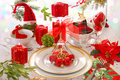 Christmas table decoration with red candles elegant in green white colors Royalty Free Stock Images