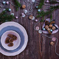 Christmas table place setting with pine branches and plate, ribbon. wooden holidays background Royalty Free Stock Photo