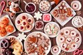 Christmas baking table scene with assorted sweets and cookies, top view over a rustic wood background Royalty Free Stock Photo
