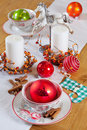Christmas table set with candles and balls Royalty Free Stock Photography