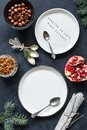 Christmas Table setting with empty white plates, vintage tea spoons, napkin Royalty Free Stock Photo