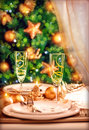 Christmas table setting festive dinner still life and beautiful decorated xmas tree at home new year eve luxury wintertime party Royalty Free Stock Photos