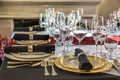 Christmas table setting for formal dinner with gold plated china sterling silverware and crystal glasses Stock Photo
