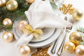 Christmas table setting in gold tones festive decorations with fir branches baubles decorations Royalty Free Stock Photos