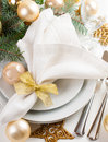 Christmas table setting in gold tones festive decorations with fir branches baubles decorations Royalty Free Stock Photography