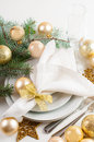 Christmas table setting in gold tones festive decorations with fir branches baubles decorations Stock Image