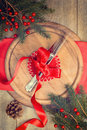 Christmas table setting with knife and fork tied with festive red ribbon Royalty Free Stock Photo