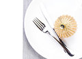 Christmas table setting place with festive ornaments on white pl plate isolated shiny golden ball fork and knife copy Royalty Free Stock Image