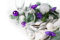 Christmas table setting in purple tones festive decoration with fir branches balls on a white background isolated Royalty Free Stock Photo