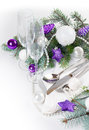 Christmas table setting in purple tones festive decoration with fir branches balls on a white background isolated Stock Photo