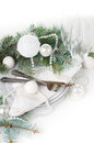 Christmas table setting table decoration in white festive with fir branches balls on a background isolated Stock Photos