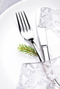 Christmas table setting in white and silver with christmas decor decorations close up Stock Photography