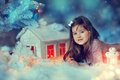 Christmas tale with a girl white fairy house lights and cute little Stock Images