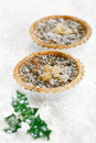 Christmas tart with mincemeat and candied peel on white snow festive background Stock Photos