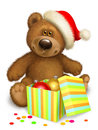 Christmas teddy bear with box in the header of santa claus and balls Royalty Free Stock Images