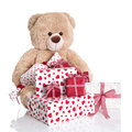 Christmas teddy bear with pile of red and white birthday or val valentines presents on background Royalty Free Stock Images