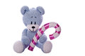 Christmas teddy bear with sugar candy cane Stock Images
