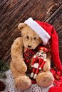 Christmas teddy bear with vintage nutcracker Royalty Free Stock Photo