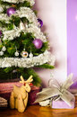Christmas three decoration with gift and christmas deer at home on a purple background Royalty Free Stock Images