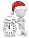 Christmas time dude the santa claus pointing at clock at to Royalty Free Stock Image