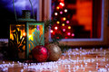 Christmas time eve decoration with lantern and tree Stock Image