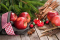 Christmas time red apples with several spices Stock Photography