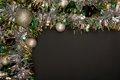 Christmas tinsel on black background is Royalty Free Stock Photography