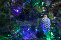 Christmas toy as a pine cone hanging on tree Royalty Free Stock Image