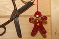 Christmas toy man red and vintage scissors on a wooden wall background Stock Photo