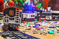Christmas toy railroad near a Christmas tree with lights Royalty Free Stock Photo